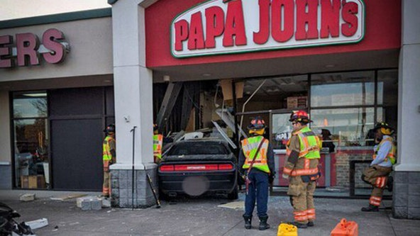 Driver loses control, crashes into Papa John's in Arlington
