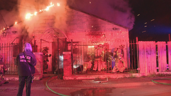 Firefighters put out flames at commercial west Dallas building