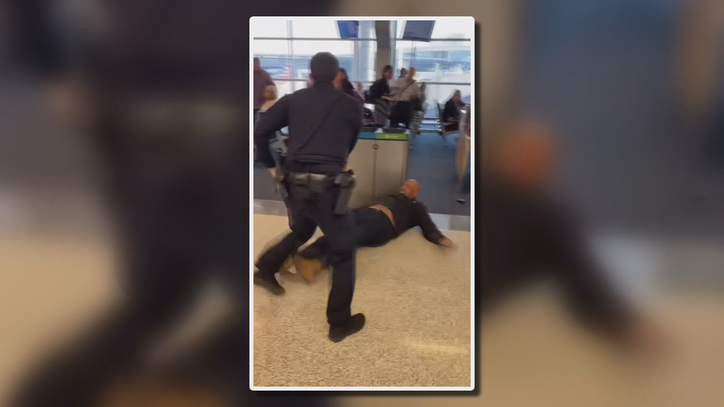 DFW Airport police use Taser on unruly traveler, but still need help from others to control him