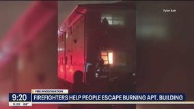 Dallas firefighters help people escape burning apartment building