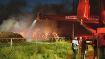 Fire smoldering at mulch business in Terrell