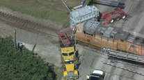 Train hits tractor-trailer in Argyle