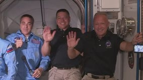 Astronauts board International Space Station after docking SpaceX Crew Dragon spacecraft
