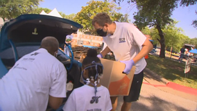 Dirk and his wife, Jessica, among those who volunteered to help give out Mother's Day meal boxes