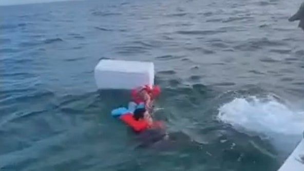 VIDEO: Men found clinging to cooler miles from Florida shore after boat sinks