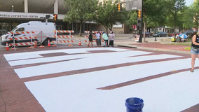 Community members help paint 'End Racism Now' on Fort Worth street
