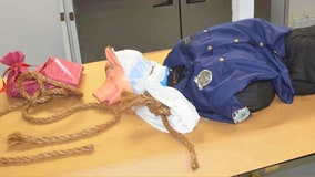 Mannequin wearing pig mask, police uniform discovered hanging from Florida interstate