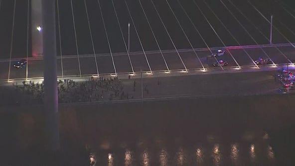 Mass arrests underway as protesters cross Dallas' Margaret Hunt Hill Bridge