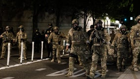 Militarized federal agents fire tear gas at protesters in Portland