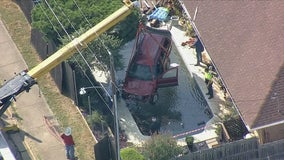SUV crashes through fence, lands in Arlington backyard pool