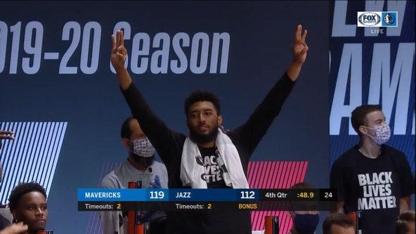 Short-handed Mavericks use huge rally to beat Jazz 122-114