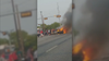 Several people help Dallas PD officers rescue man from burning car