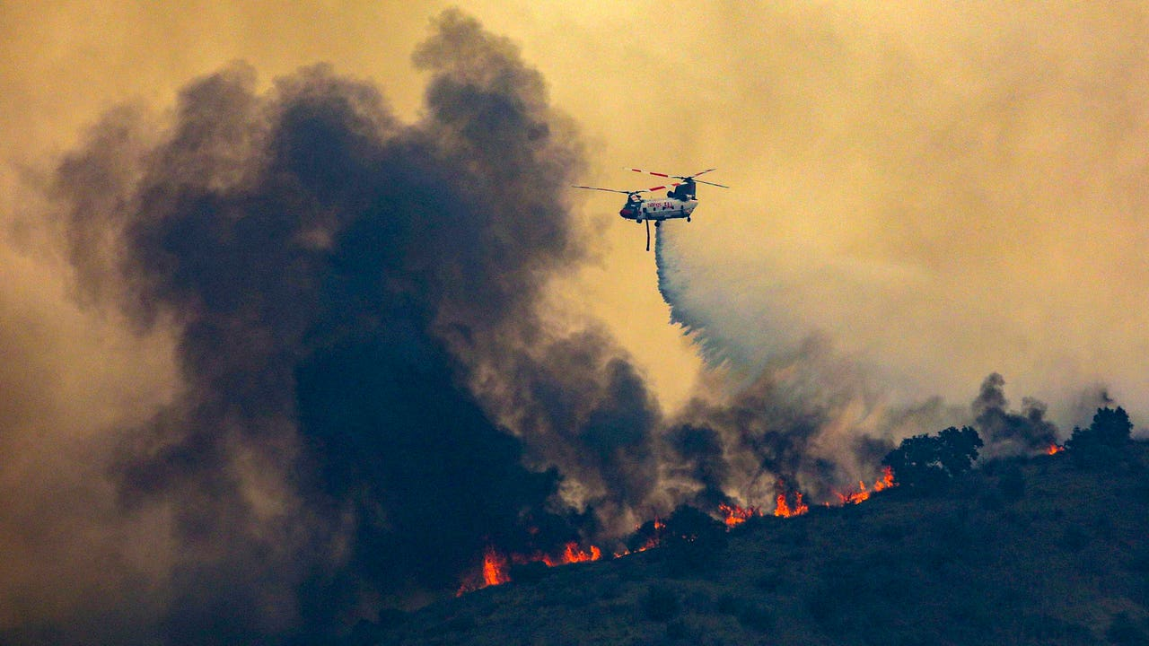 Southern California wildfires force 80,000 to flee as...