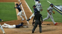 Stumbling stunner! Rays shock Dodgers in 9th, tie Series 2-2