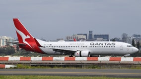 Qantas airline plans to require coronavirus vaccine for international travel, CEO says