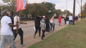 Group holds unity walk in South Dallas to reclaim the area as a place of peace