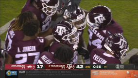 Mond leads No. 8 Texas A&M to 42-31 win over Arkansas