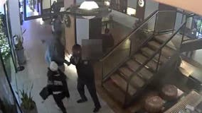 NYPD releases video of woman tackling boy over phone in hotel lobby