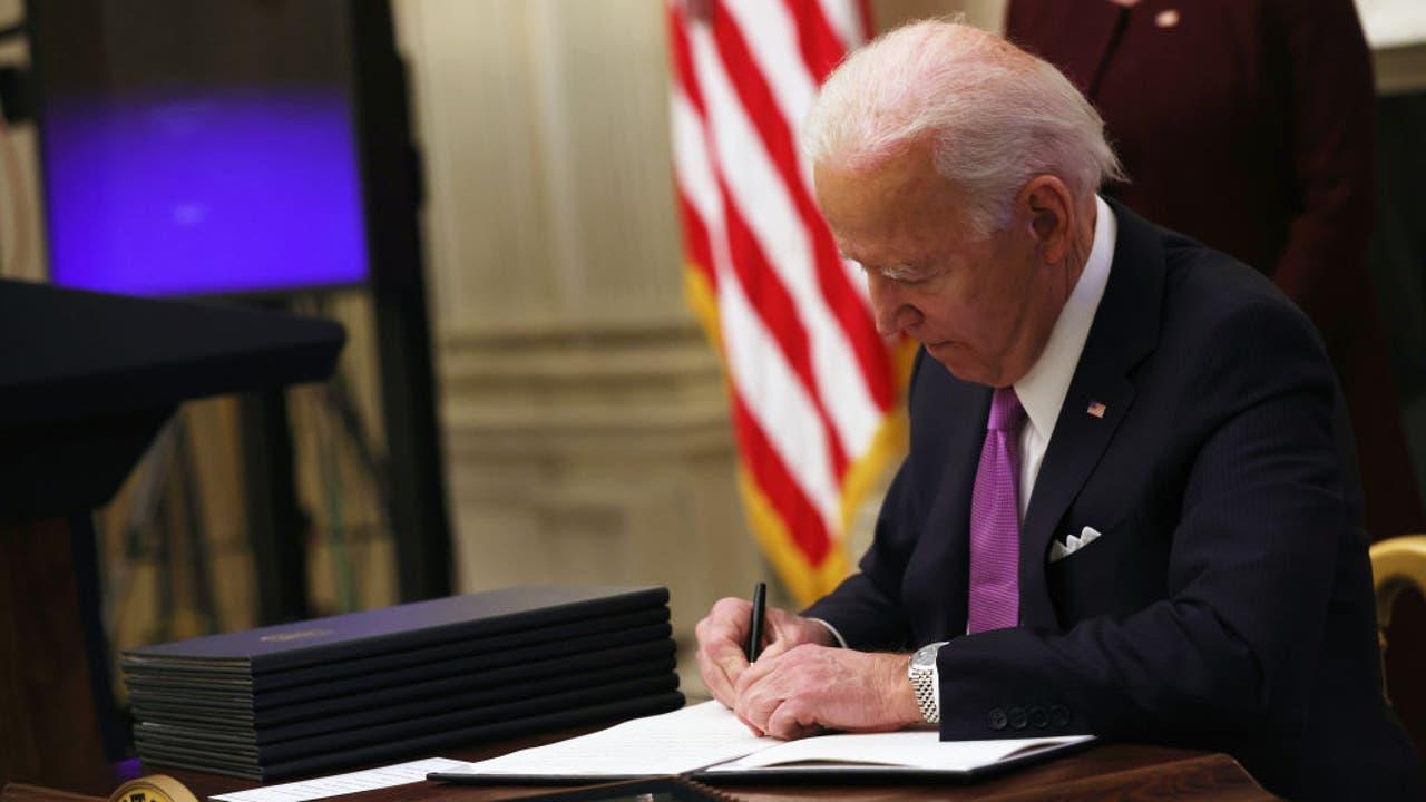 Biden signs executive orders on $15 minimum wage...