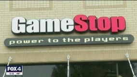 Gamestop shares fall sharply after brokerage firms restrict trading