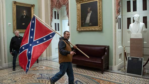 FBI: Delaware man seen holding confederate flag during Capitol riot surrenders
