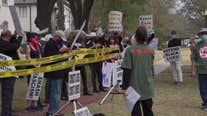 Mariachi band plays as protestors gather outside Sen. Ted Cruz's Houston home