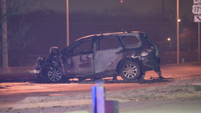 Dallas PD officers, Good Samaritans help people get out of burning vehicle after Dallas crash