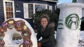 Art teacher's larger-than-life snow sculptures encouraging students to play outside amid remote learning