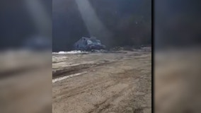 Vehicles swallowed when massive embankment collapses in Kentucky