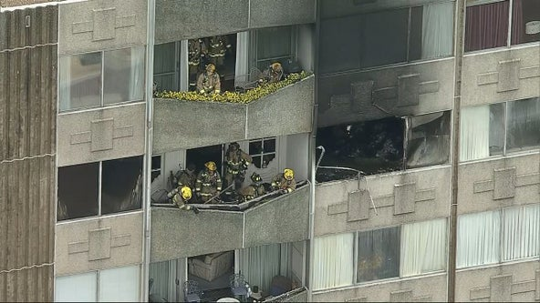 Firefighters help elderly residents evacuate during Dallas high-rise apartment fire