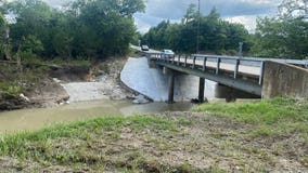 Body found after woman called 911 as her vehicle was trapped in high waters in Garland
