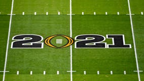 College Football Playoff to expand to 12 teams, AP source says