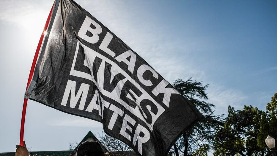 A protester waves a Black Lives Matter flag during the