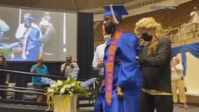 DeSoto's Corey Borner continues his inspirational story by walking across stage at his graduation