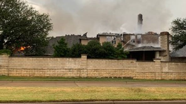 Lightning strike believed to be the cause of fire at Arlington home during Sunday's storms