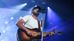 Country singer Luke Bryan helps change woman's tire  in Tennessee