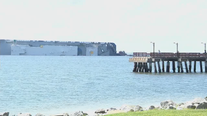 Salvage experts to haul overturned cargo ship away in pieces