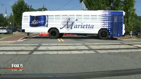 Marietta school buses get makeover for holiday weekend