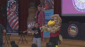 Falcons surprise school with grant
