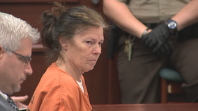 Woman accused of killing her husband, burning body in court