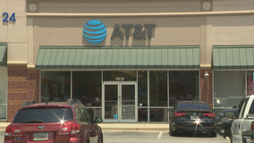 Police: Armed robbers target busy phone store