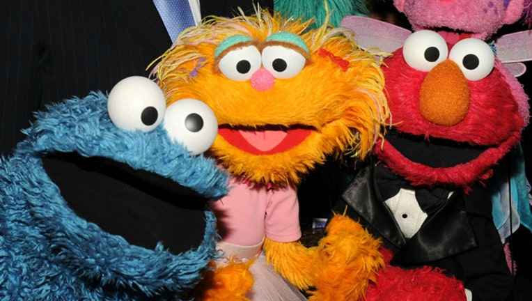 6e894ea1-GETTY Sesame Street characters Cookie Monster and Elmo-404023