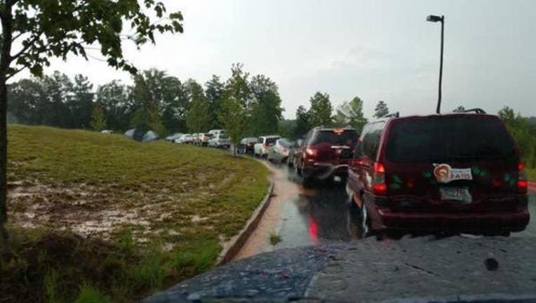 Stuck in rainy traffic Denise Dillon
