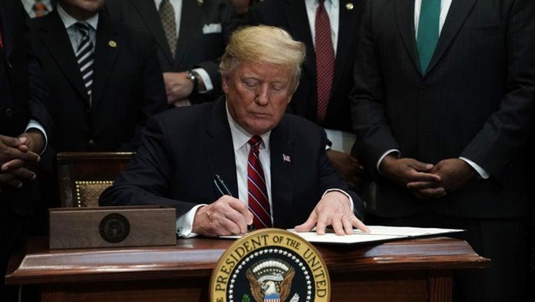 0c460f24-GETTY President Trump at Desk-401096