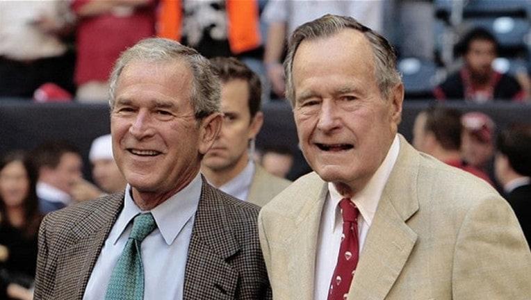 49a2d5b1-George HW Bush and George W Bush _1502900074836-409650.jpg