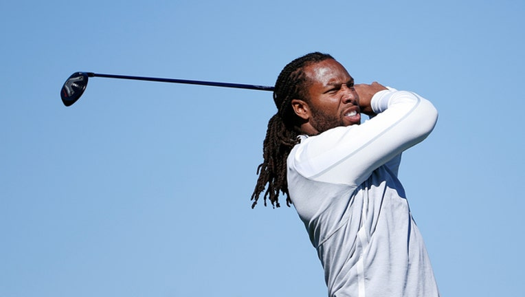 1dc75655-GETTY Larry Fitzgerald Playing Golf 011819-408200