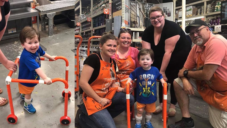 6723a063-Logan and his walker with Home Depot employees_1559061855794.jpg-408795.jpg