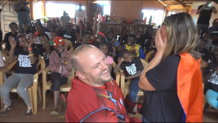 60e3e1d5-Man flies to Africa for the best superhero proposal ever_1503671276843.png