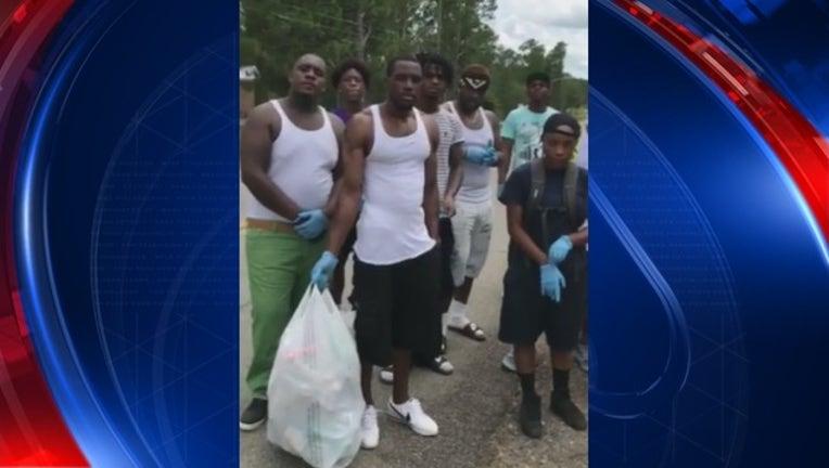 42ebc403-Neighbor shares video of Georgia teens cleaning up community_1500766647409.jpg