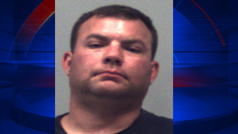 P GWINNETT OFFICER ARRESTED SIG OUT 7A_00.00.40.25_1470741229603.png